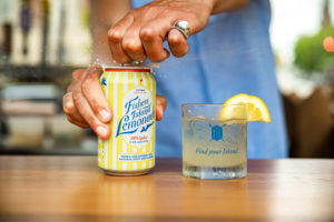cracking open can of Fishers Island Lemonade
