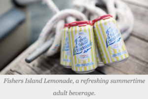 cans of fishers island lemonade on a boat dock next to rope anchor