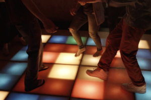 light up dance floor with people dancing at the Pequot Inn